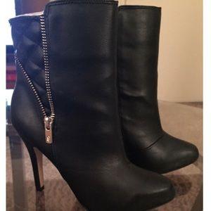 Black zippered booties.